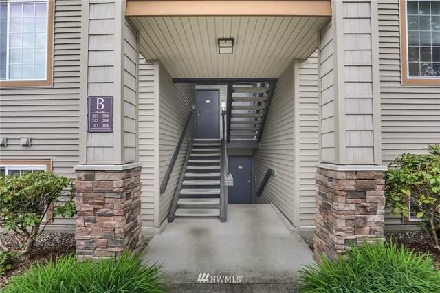 25025 SE Klahanie Boulevard B304, Issaquah, WA 98029 (#1768295) :: Simmi Real Estate