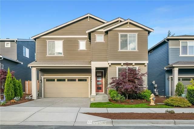 12922 136th Place NE, Kirkland, WA 98034 (#1772215) :: McAuley Homes