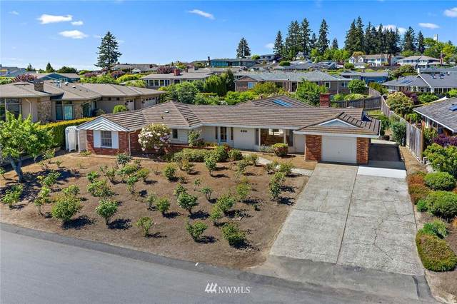 9810 Vineyard Crest, Bellevue, WA 98004 (#1772959) :: Northern Key Team