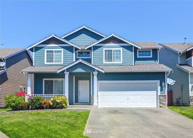 10712 SE 260th Place, Kent, WA 98030 (#1774176) :: Keller Williams Western Realty