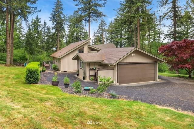 5909 NE Lockwood Creek Road, La Center, WA 98629 (#1777140) :: Keller Williams Western Realty
