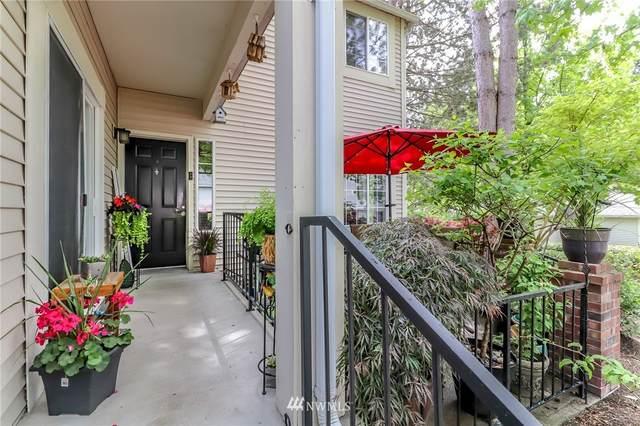 10909 Avondale Road NE H130, Redmond, WA 98052 (#1784759) :: Icon Real Estate Group