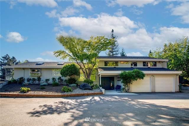 10501 NE 47th Place, Kirkland, WA 98033 (#1785646) :: Keller Williams Western Realty