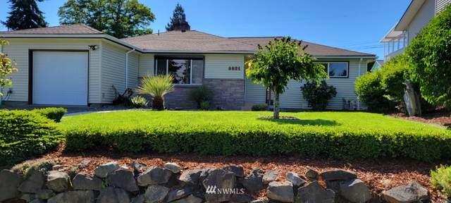 8821 29th Avenue SW, Seattle, WA 98216 (#1797953) :: Stan Giske