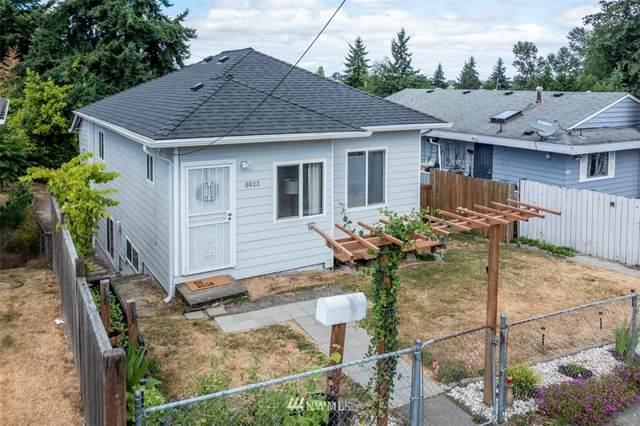 9823 57th Avenue S, Seattle, WA 98118 (#1803043) :: Stan Giske