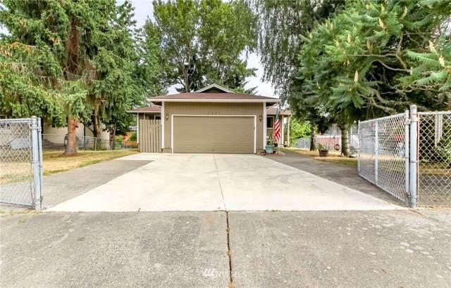 1225 E 62nd Street, Tacoma, WA 98404 (#1803492) :: Stan Giske