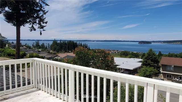 1027 N Sunset Drive, Camano Island, WA 98282 (#1804363) :: Keller Williams Western Realty