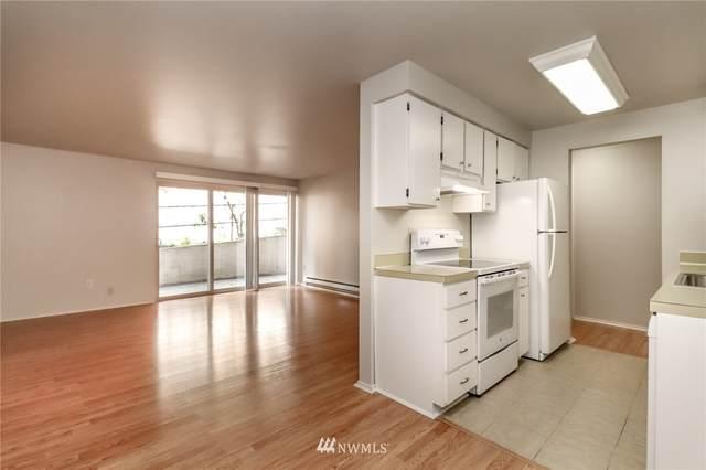 11010 NE 68th Street #604, Kirkland, WA 98033 (#1805427) :: NextHome South Sound