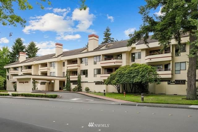 401 100th Avenue NE #218, Bellevue, WA 98004 (#1810667) :: Alchemy Real Estate
