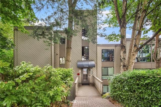3710 26th Place W #204, Seattle, WA 98199 (#1811616) :: Stan Giske