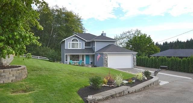 7247 NE Beach Avenue, Poulsbo, WA 98370 (#1820408) :: Better Homes and Gardens Real Estate McKenzie Group