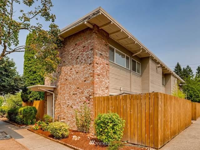 12245 SE 56th Street #305, Bellevue, WA 98006 (#1822630) :: Pacific Partners @ Greene Realty