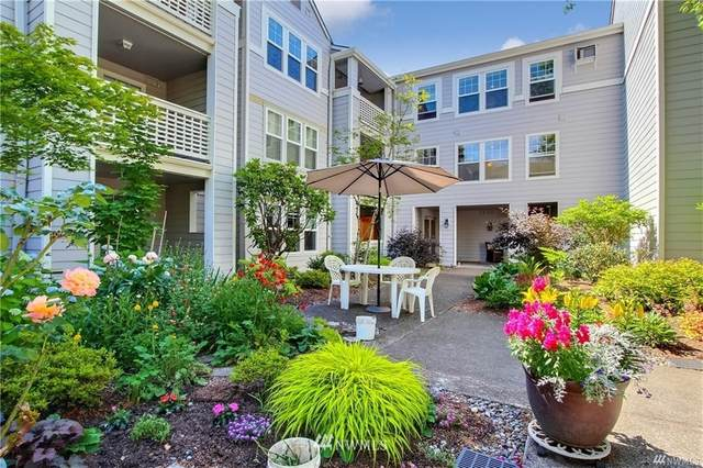 3941 226th Place SE #214, Issaquah, WA 98029 (#1835417) :: Pacific Partners @ Greene Realty