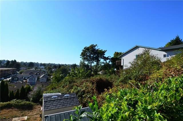 6221 48th Avenue S, Seattle, WA 98118 (#1835459) :: Pacific Partners @ Greene Realty
