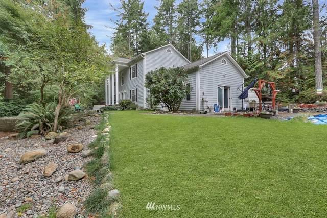 8705 Honeycomb Court NW, Seabeck, WA 98380 (#1854422) :: McAuley Homes