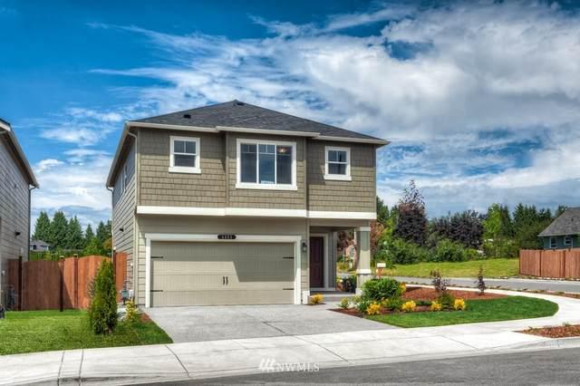 18763 108th Avenue E #602, Puyallup, WA 98374 (#1854893) :: Neighborhood Real Estate Group