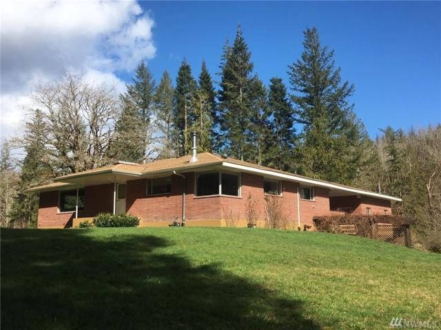 292465 Highway 101, Quilcene, WA 98376 (#1086777) :: Ben Kinney Real Estate Team