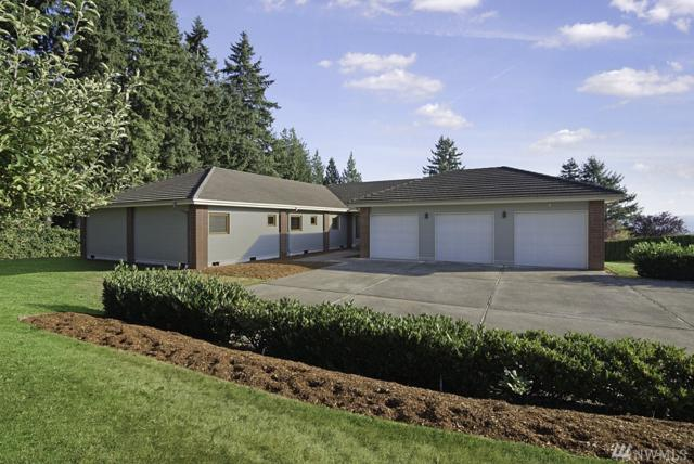9117 135th Dr SE, Snohomish, WA 98290 (#1179487) :: Homes on the Sound