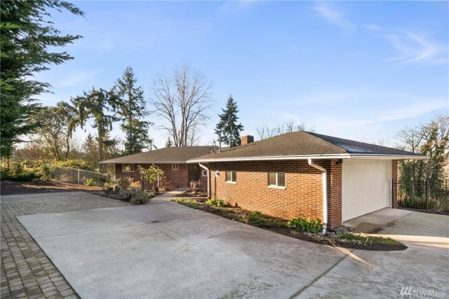 4255 120th Ave SE, Bellevue, WA 98006 (#1224200) :: Homes on the Sound