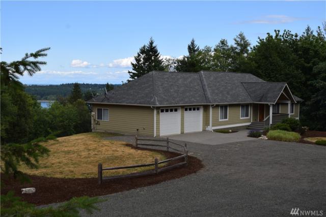 1257 NE Hoffs Dr, Poulsbo, WA 98370 (#1230272) :: Mike & Sandi Nelson Real Estate