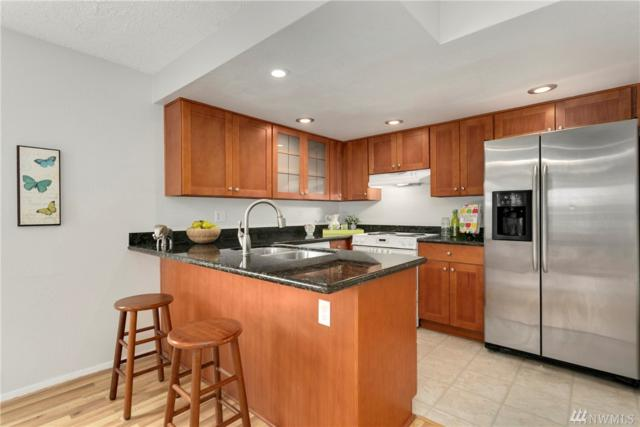 707 141st Lane SE #707, Bellevue, WA 98007 (#1289213) :: Homes on the Sound