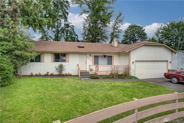 5718 NE 204th Place, Kenmore, WA 98028 (#1293995) :: McAuley Real Estate