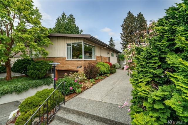 7046 Cleopatra Place NW, Seattle, WA 98117 (#1295122) :: Morris Real Estate Group
