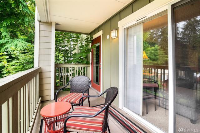7711 NE 175th St F206, Kenmore, WA 98028 (#1331602) :: McAuley Real Estate
