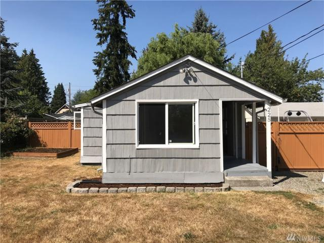 225 E 65th St, Tacoma, WA 98404 (#1337647) :: Better Homes and Gardens Real Estate McKenzie Group