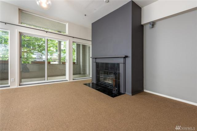 526 1st Ave S #205, Seattle, WA 98104 (#1340611) :: Carroll & Lions