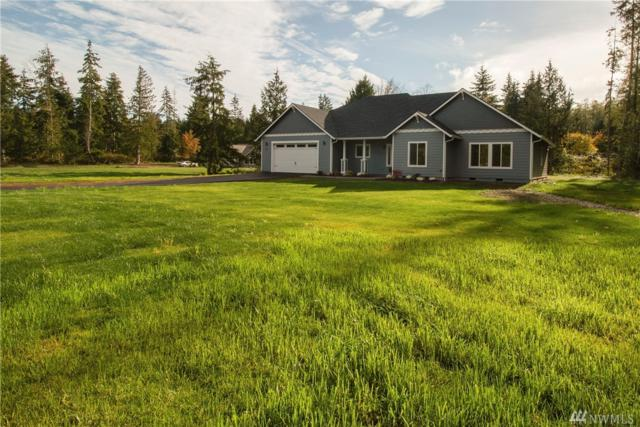 8301 NE Broughton Ct, Hansville, WA 98340 (#1381059) :: The Royston Team