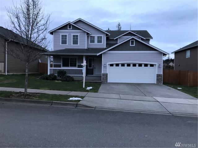 7162 288th St NW, Stanwood, WA 98292 (#1409871) :: Hauer Home Team