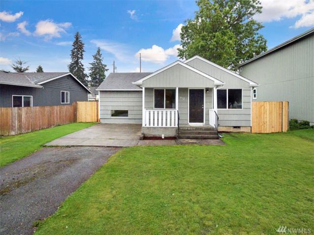 912 E 63rd St, Tacoma, WA 98404 (#1458998) :: The Kendra Todd Group at Keller Williams