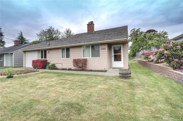 11311 14th Ave SW, Seattle, WA 98146 (#1460539) :: The Kendra Todd Group at Keller Williams