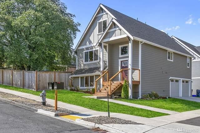 941 E 50th St, Tacoma, WA 98404 (#1500196) :: Keller Williams Western Realty