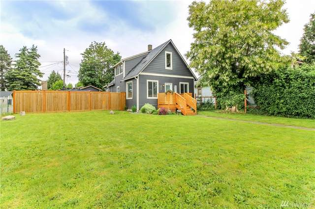717 S 58th St, Tacoma, WA 98408 (#1606360) :: Real Estate Solutions Group