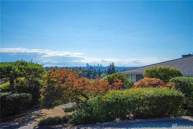 909 95th Ave NE, Bellevue, WA 98004 (#1640367) :: Keller Williams Western Realty