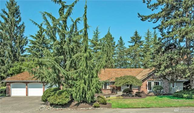 8422 NE 27th Place, Clyde Hill, WA 98004 (#1641462) :: Better Properties Lacey