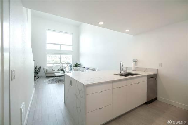 2219 14 Ave W #404, Seattle, WA 98119 (#1642409) :: Alchemy Real Estate