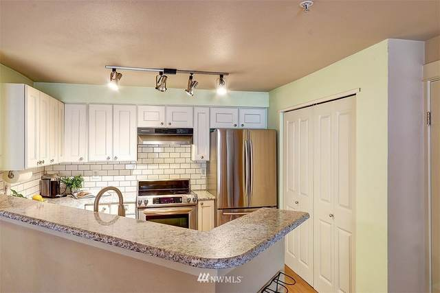 7711 NE 175th Street E 205, Kenmore, WA 98028 (#1647347) :: Real Estate Solutions Group