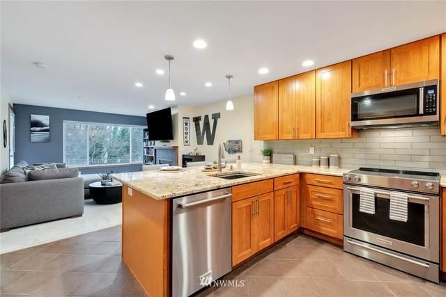 2334 Thorndyke Avenue W #103, Seattle, WA 98199 (#1733693) :: The Royston Team