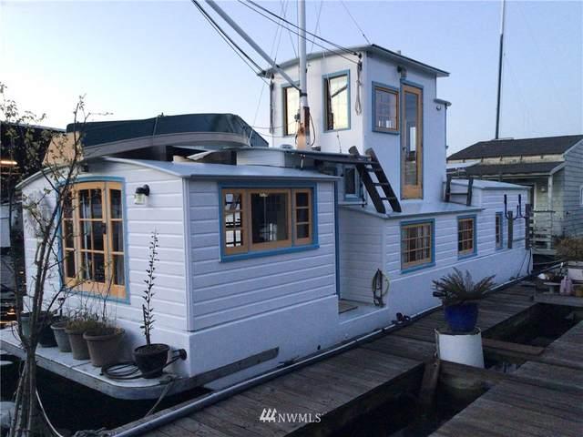 1080 W Ewing Place E8, Seattle, WA 98119 (#1756906) :: Northwest Home Team Realty, LLC