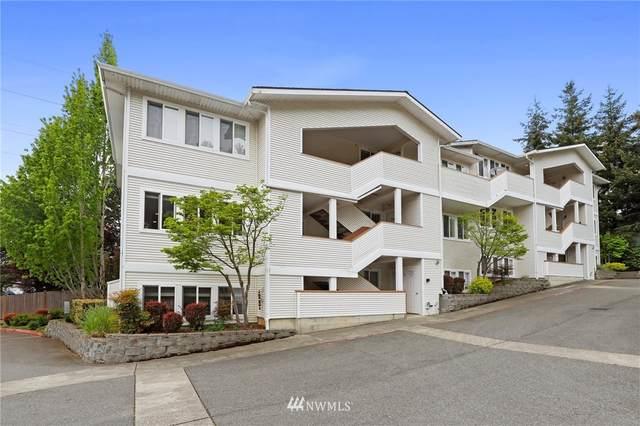 12406 SE 31st Street #201, Bellevue, WA 98005 (#1768363) :: Keller Williams Western Realty
