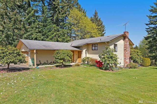 13606 NE 104th St, Kirkland, WA 98033 (#1280230) :: McAuley Real Estate