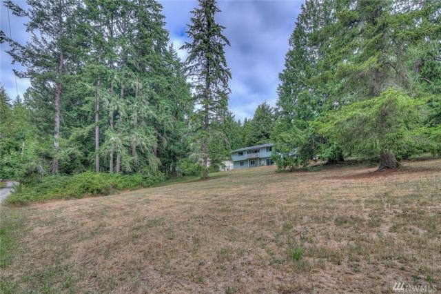 8235 NE Fireside Lane, Poulsbo, WA 98370 (#1333343) :: Icon Real Estate Group
