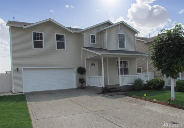 12703 SE 295th St, Auburn, WA 98092 (#1305601) :: Homes on the Sound