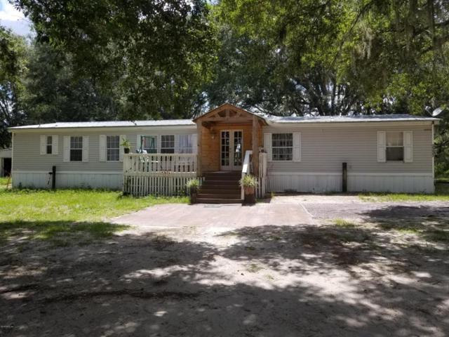 2227 NW 12th Avenue, Lake Panasoffkee, FL 33538 (MLS #537904) :: Bosshardt Realty