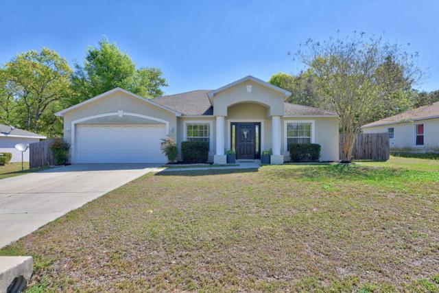24 Pine Ct Loop, Ocala, FL 34472 (MLS #553301) :: Thomas Group Realty