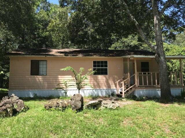 1276 NW 112th Avenue, Ocala, FL 34482 (MLS #557144) :: The Dora Campbell Team