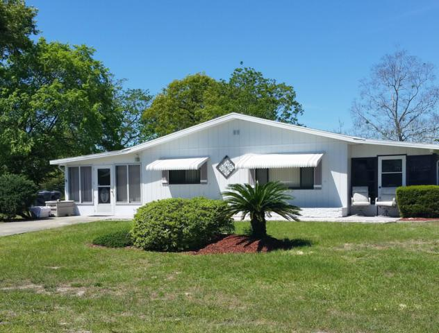 10080 SW 95th Avenue, Ocala, FL 34481 (MLS #557543) :: Realty Executives Mid Florida